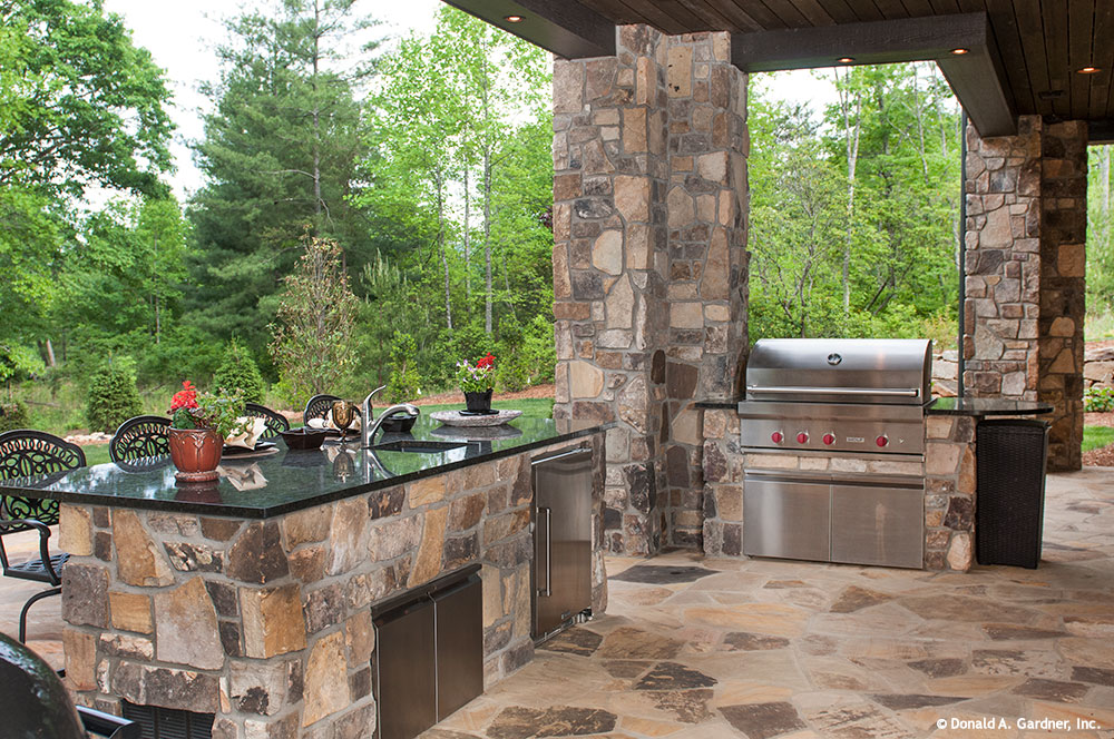 NEW HOUSING TRENDS 2015: The Great Outdoors. Outdoor kitchen of the Jasper Hill Plan #5020